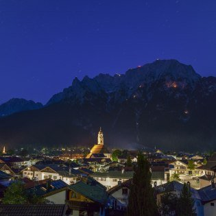Mittenwald with mountain fire on the eve of St. John's Day